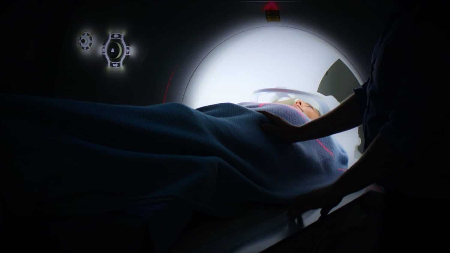 a person going into a MRI scan