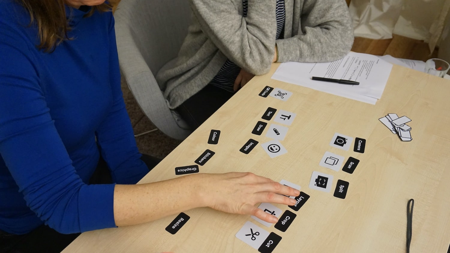 a participant during a usability test conducting a card sorting exercise