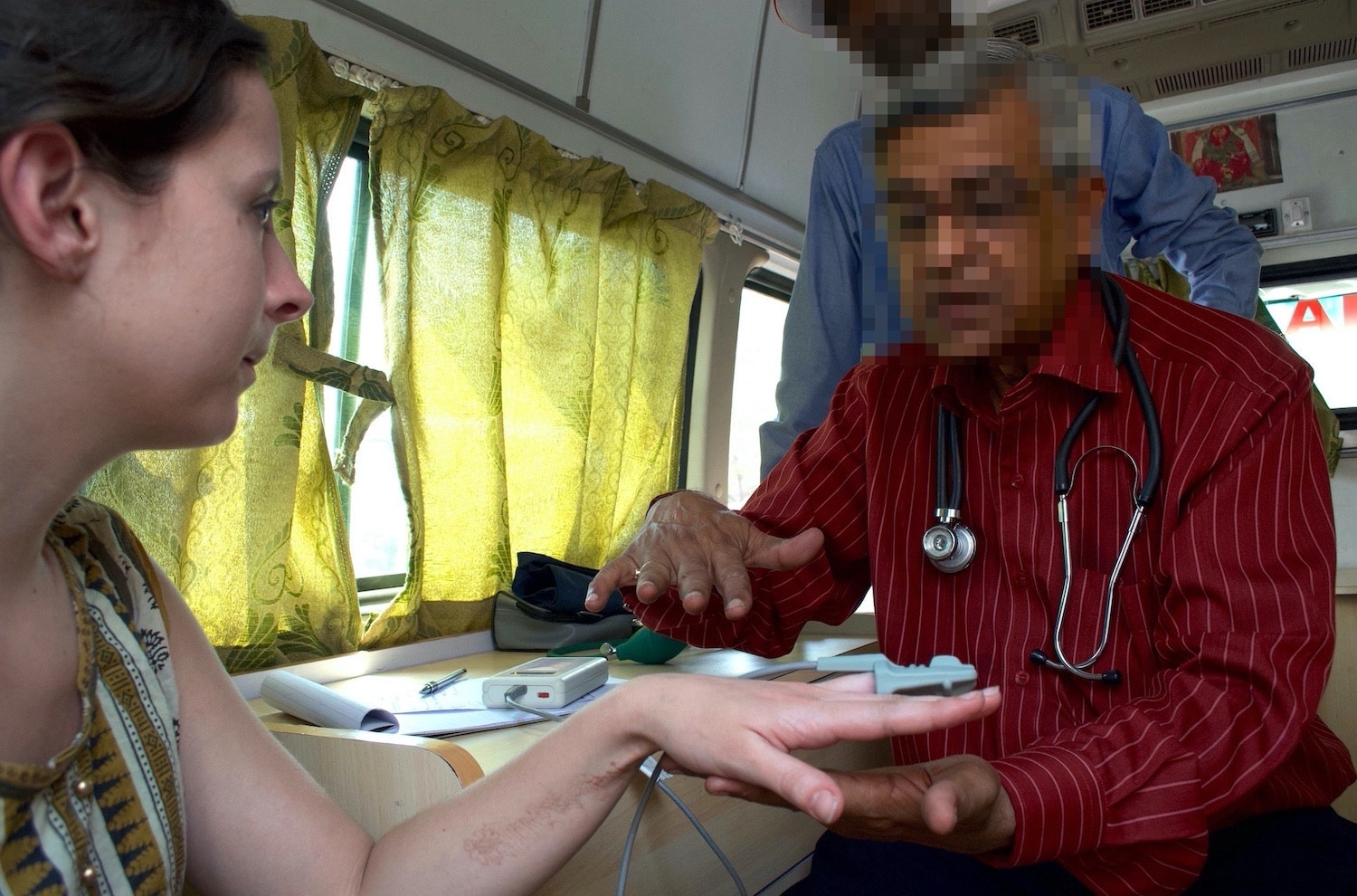roleplaying with doctors at a mobile medical centre in India